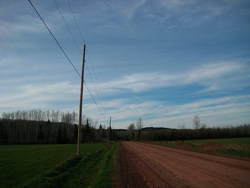 blue sky and red dirt road.